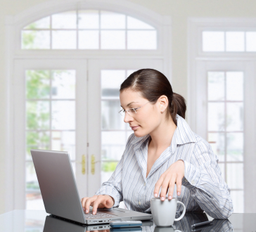 Woman at Home at Computer